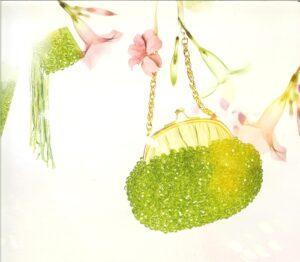 Borsa e bracciale in camoscio verde con ricamo in perle cristallo verde